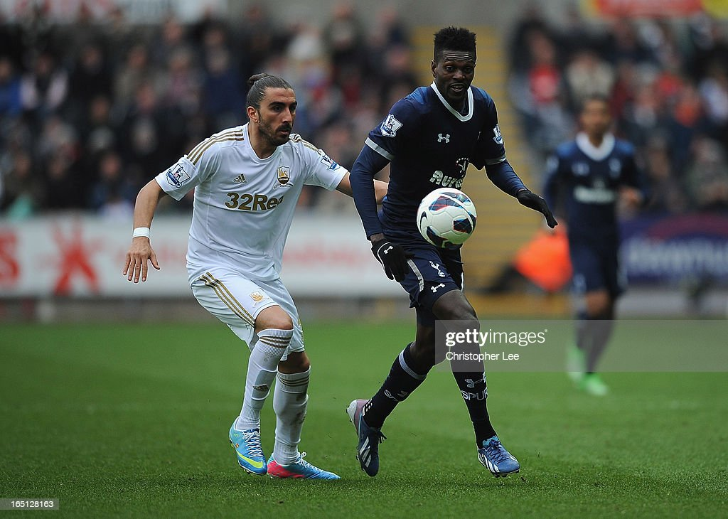 Chico Flores of Swansea battles with <a gi-track='captionPersonalityLinkClicked' href=/galleries/search?phrase=Emmanuel+Adebayor&family=editorial&specificpeople=484018 ng-click='$event.stopPropagation()'>Emmanuel Adebayor</a> of Spurs during the Barclays Premier League match between Swansea City v Tottenham Hotspur at Liberty Stadium on March 30, 2013 in Swansea, Wales.