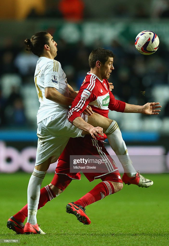 Chico Flores (L) of Swansea City challenges Lukas Jutkiewicz (R) of Middlesbrough during the Capital One Cup Quarter-Final match between Swansea City and Middlesbrough at the Liberty Stadium on December 12, 2012 in Swansea, Wales.