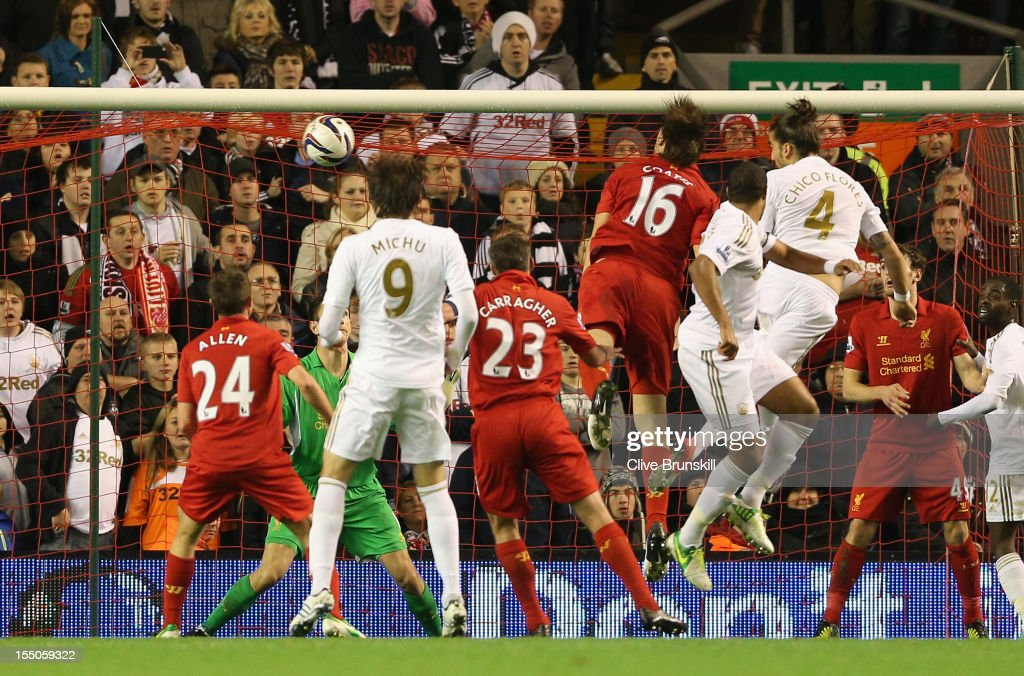 Chico Flores of Swansea City heads the opening goal during the Capital One Cup Fourth Round match between Liverpool and Swansea City at Anfield on October 31, 2012 in Liverpool, England.