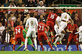 Chico Flores of Swansea City heads the opening goal during the Capital One Cup Fourth Round match between Liverpool and Swansea City at Anfield on...