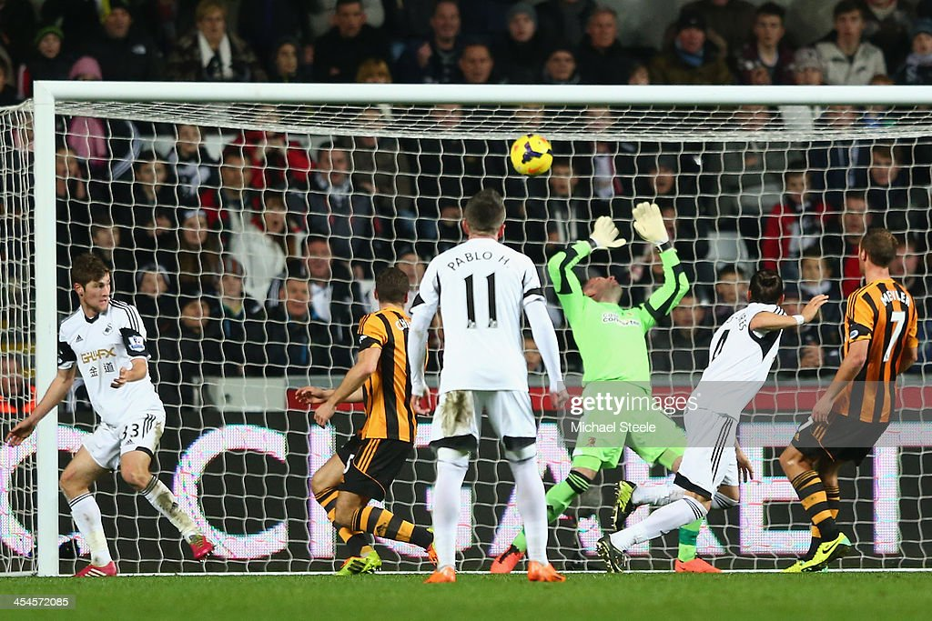 Chico Flores (2R) of Swansea City scores his sides equalising goal during the Barclays Premier League match between Swansea City and Hull City at the Liberty Stadium on December 9, 2013 in Swansea, Wales.