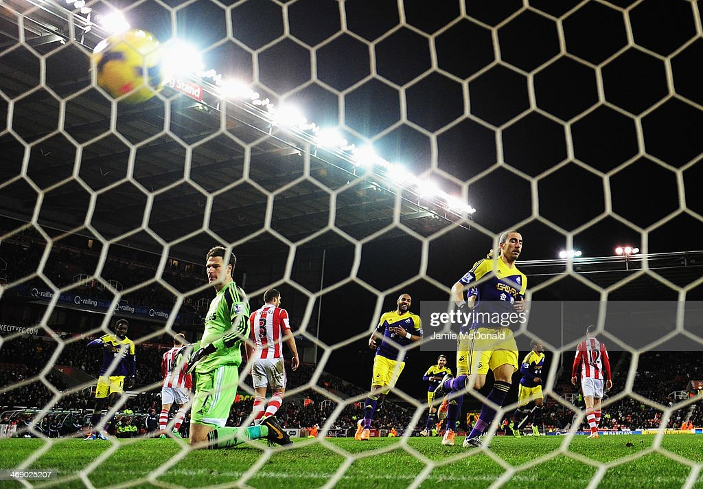 Chico Flores of Swansea City scores past Asmir Begovic the Stoke City goalkeeper during the Barclays Premier League match between Stoke City and...