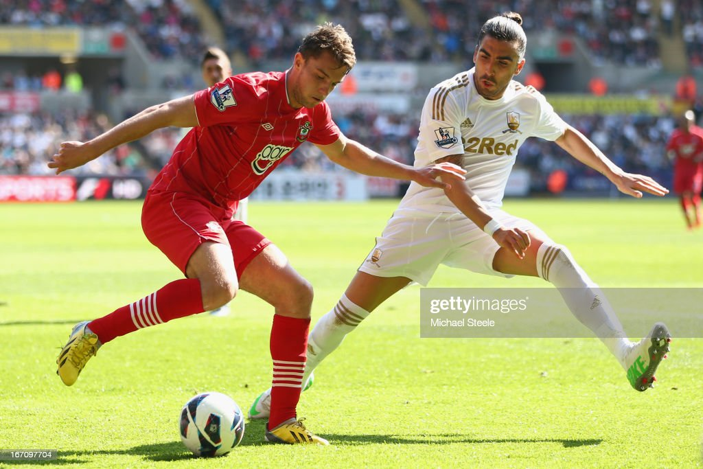 Chico Flores (R) of Swansea City tracks Jay Rodriguez (L) of Southampton during the Barclays Premier League match between Swansea City and Southampton at the Liberty Stadium on April 20, 2013 in Swansea, Wales.