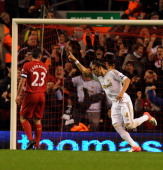 Chico Flores of Swansea scores the first goal during the Capital One Cup Fourth Round match between Liverpool and Swansea City at Anfield on October...