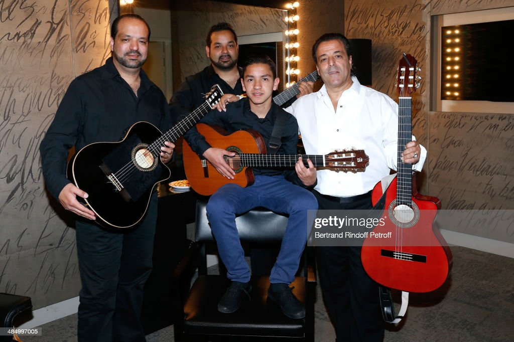 Chico (R), his sons Reda (L), Tonino (2nd L) and his grandson Tambo (2nd R) pose before the Concert of 'Chico & The Gypsies' with 50 gypsy guitars at L'Olympia on April 15, 2014 in Paris, France.