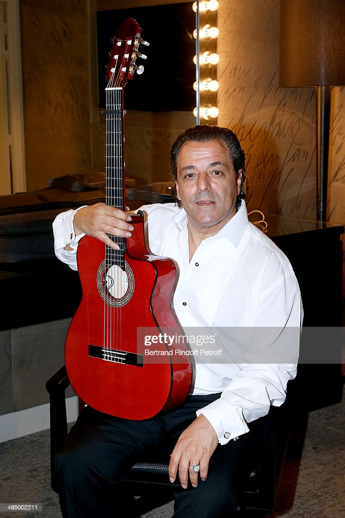Chico poses after the Concert of 'Chico & The Gypsies' with 50 gypsy guitars at L'Olympia on April 14, 2014 in Paris, France.