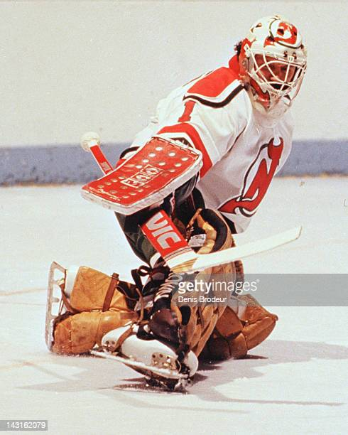 Chico Resch of the New Jersey Devils makes a save against the Montreal Canadiens Circa 1983 at the Montreal Forum in Montreal Quebec Canada