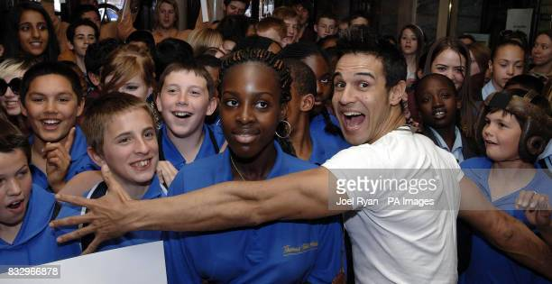 Chico Slimani holds back some of the 1500 school children drawn from various London state schools before they watch a special performance of Billy...