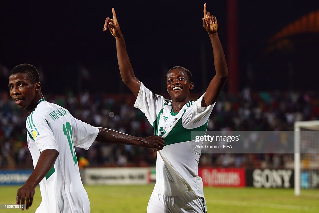 Chidera Ezeh (R) of Nigeria celebrates his team's third goal with team mate Kelechi Iheanacho during the FIFA U-17 World Cup UAE 2013 Semi Final match between Sweden and Nigeria at Al Rashid Stadium on November 5, 2013 in Dubai, United Arab Emirates.