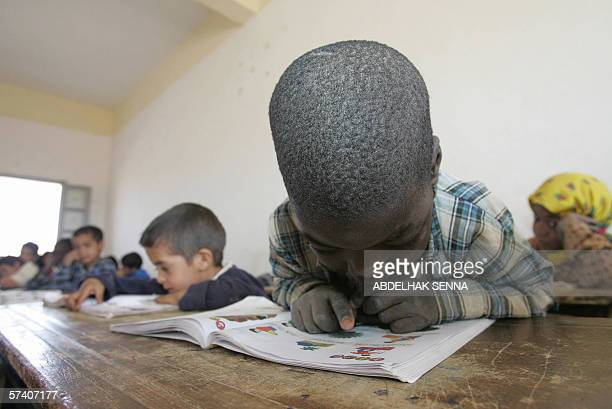 Chidren read in their classroom in Sidi Ali south east of Morocco near the border with Algeria 21 April 2006 The High Commissariat for Planning in a...