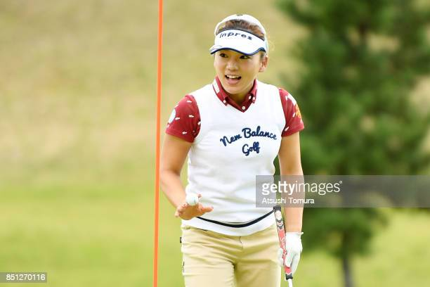 Chie Arimura of Japan celebrates after chipping in her second shot on the 17th hole during the first round of the Miyagi TV Cup Dunlop Ladies Open...