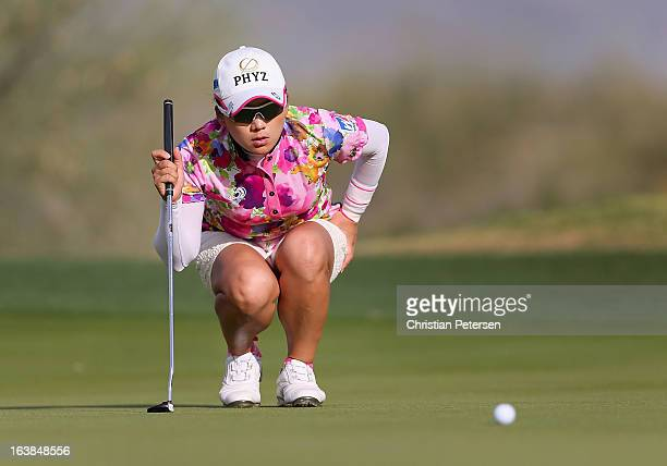 Chie Arimura of Japan lines up a putt on the 16th hole green during the second round of the RR Donnelley LPGA Founders Cup at Wildfire Golf Club on...