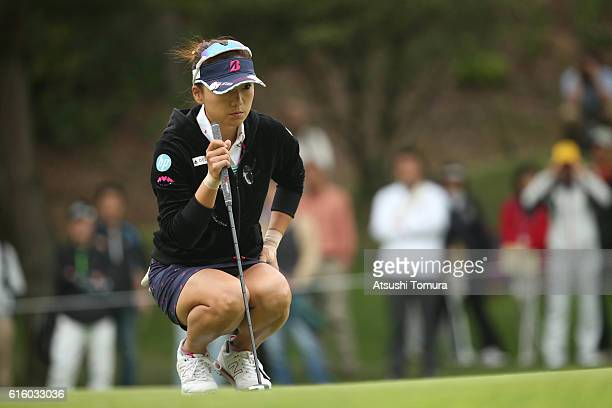 Chie Arimura of Japan lines up her putt on the 1st hole during the third round of the Nobuta Group Masters GC Ladies at the Masters Golf Club on...