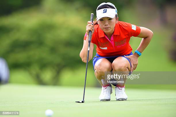 Chie Arimura of Japan lines up on the 7th hole during the first round of the Suntory Ladies Open at the Rokko Kokusai Golf Club on June 9 2016 in...