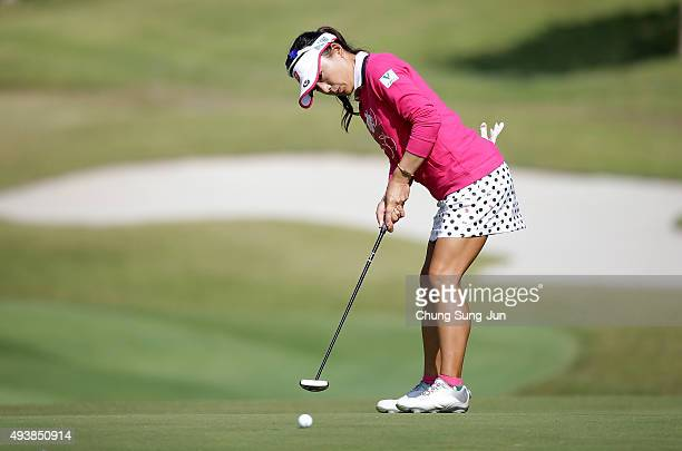 Chie Arimura of Japan plays a putt on the 1st hole during the second round of the Nobuta Group Masters GC Ladies at the Masters Gold Club on October...