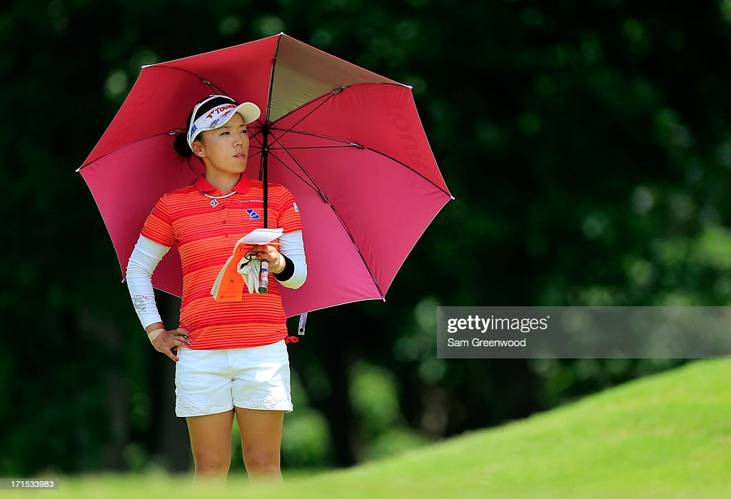 Chie Arimura of Japan plays a shot during the final round of the Walmart NW Arkansas Championship Presented by P&G at the Pinnacle Country Club on June 23, 2013 in Rogers, Arkansas.