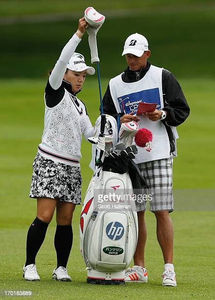 Chie Arimura of Japan pulls a club on the third hole during the weatherdelayed second round of the Wegmans LPGA Championship at Locust Hill Country...