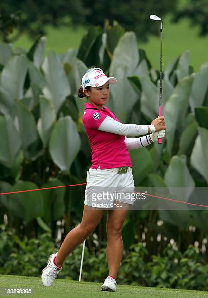 Chie Arimura of Japan watches her second shot on the 12th hole during day one of the Sime Darby LPGA Malaysia at Kuala Lumpur Golf Country Club on...