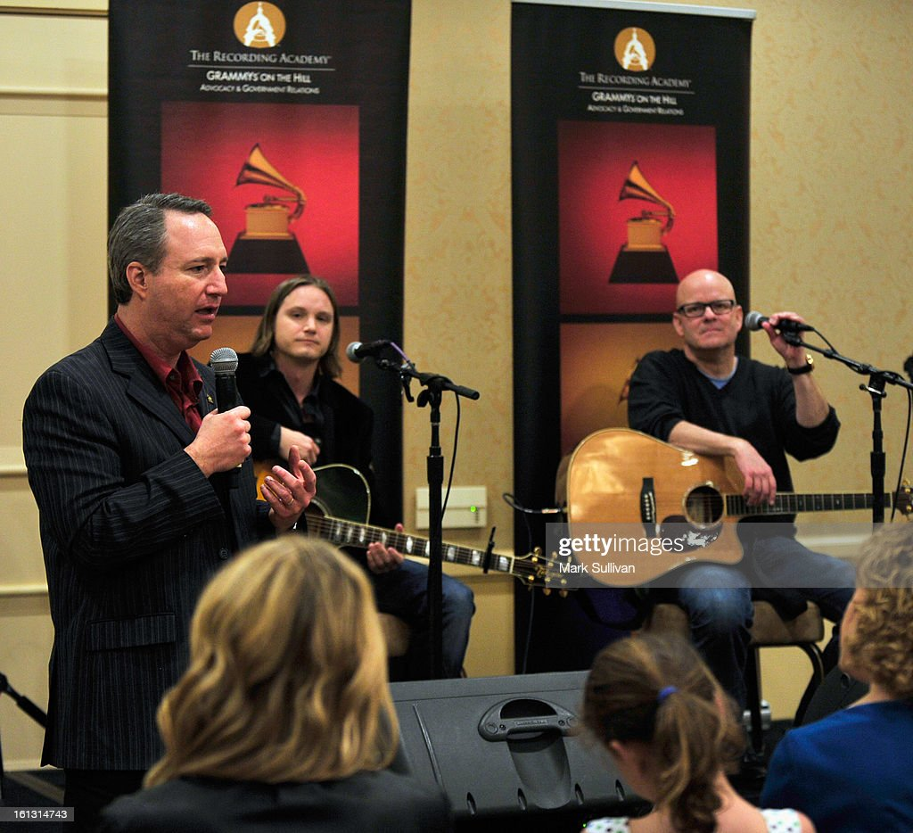 Chief Advocacy & Industry Relations Officer for The Recording Academy Daryl P. Friedman (L) introduces Josh Kear and Mark Bright during The 55th Annual GRAMMY Awards - Congressional Briefing held at The Beverly Hilton Hotel on February 9, 2013 in Beverly Hills, California.