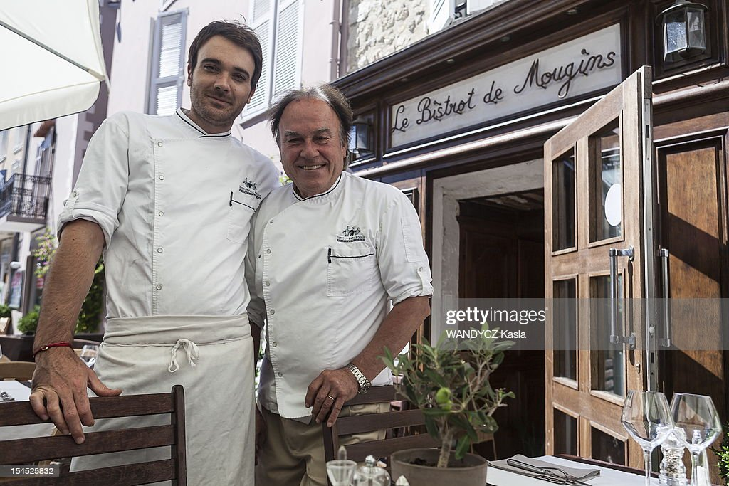 Chief Alain Ballatore and his son Laurent in front of their restaurant 'Le Bistrot de Mougins' where they offer Provencal gastronomy during the 7th International Food Festival in Mougins on october 14, 2012 in Mougins on the Cote d'Azur.