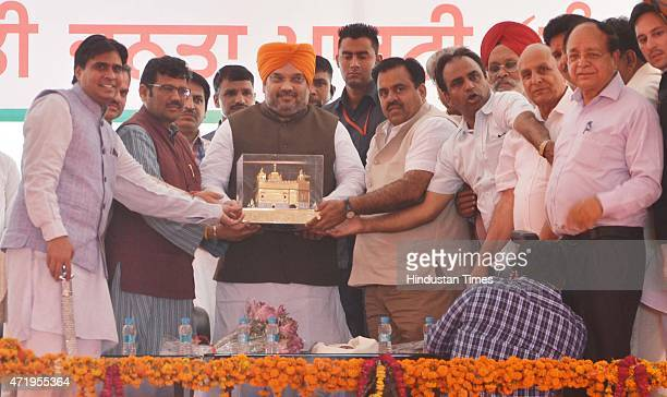 BJP chief Amit Shah addressing being honored by State president kamal Sharma and National Secretary Tarun Chugh during the BJP active members...