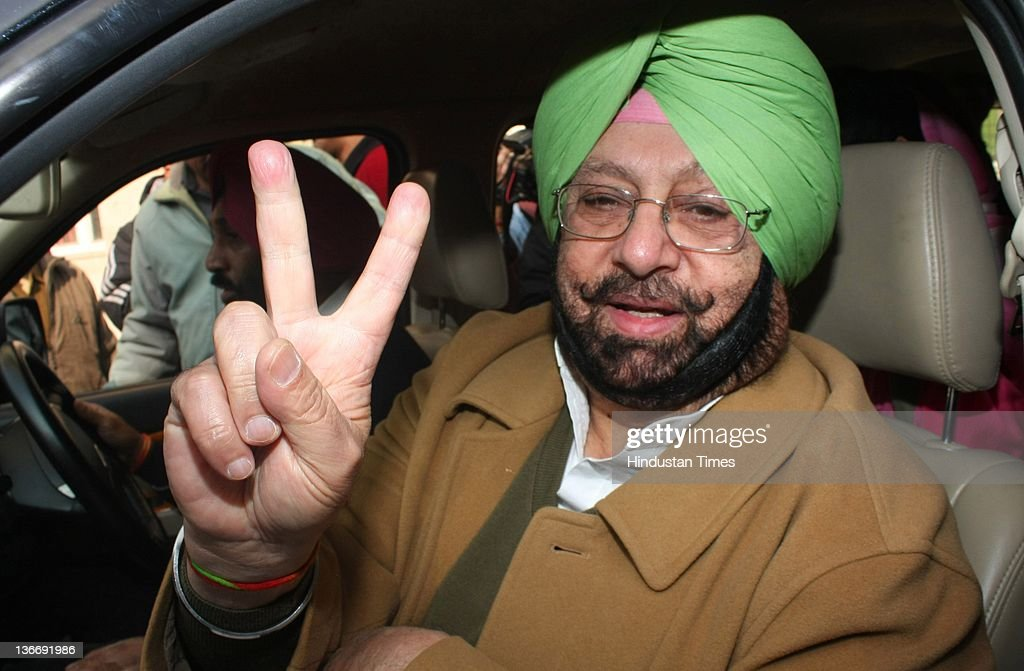 Chief and former CM of Punjab Capt. <a gi-track='captionPersonalityLinkClicked' href=/galleries/search?phrase=Amarinder+Singh&family=editorial&specificpeople=2907726 ng-click='$event.stopPropagation()'>Amarinder Singh</a> showing victory sign after filing the nomination form as a Congress candidate from Patiala seat on January 10, 2012 in Patiala, India. The state assembly election in Punjab is scheduled on January 30 this year.