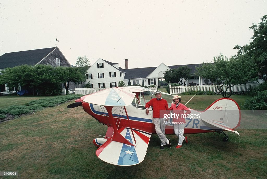 IBM chief and son of its founder Thomas Watson Jr. (1914 - 1993) and his wife Olive with their bi-plane in their garden in Maine, July 1992.