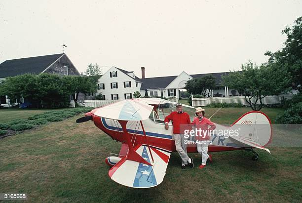 IBM chief and son of its founder Thomas Watson Jr and his wife Olive with their biplane in their garden in Maine July 1992