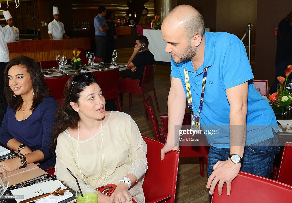 Chief Arab programmer Hania Mroue for the Doha Tribeca Film Festival (L) talks to director Damien Ounouri of ?Fidaï? attends the Awards Lunch during the 2012 Doha Tribeca Film Festival at St Regis Hotel on November 23, 2012 in Doha, Qatar.