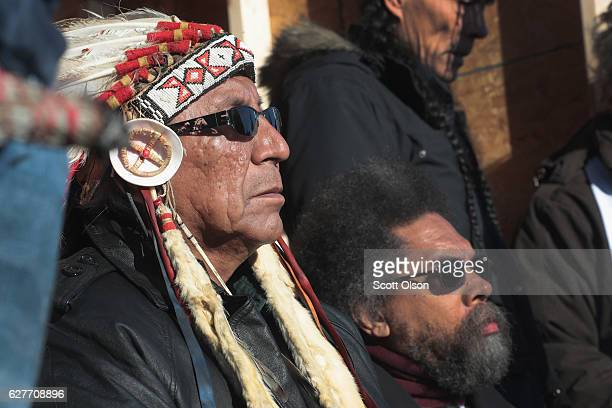 Chief Arvol Looking Horse of the Lakota/Dakota/Nakota Nation and political activist Cornel West listen to speakers during an interfaith ceremony at...