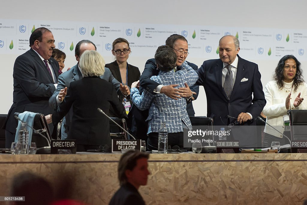 Chief Ban Ki-Moon (C) hugs Executive Secretary of the United Nations Framework Convention on Climate Change (UNFCCC) <a gi-track='captionPersonalityLinkClicked' href=/galleries/search?phrase=Christiana+Figueres&family=editorial&specificpeople=7113536 ng-click='$event.stopPropagation()'>Christiana Figueres</a> (C) after the adoption of a historic global warming pact at the COP21 Climate Conference in Paris.