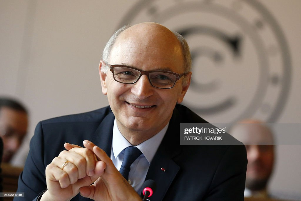 Chief Baron of the Court of Audit of France, Didier Migaud smiles during the presentation of the annual report of the Court of Auditors on February 10, 2016 in Paris. / AFP / PATRICK KOVARIK