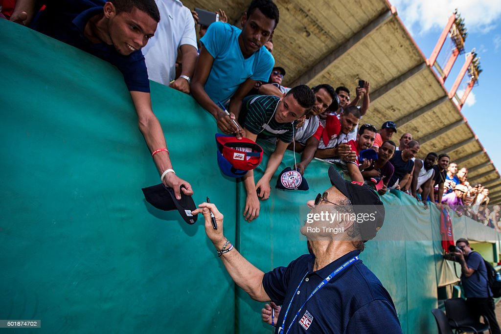 Chief Baseball Officer <a gi-track='captionPersonalityLinkClicked' href=/galleries/search?phrase=Joe+Torre&family=editorial&specificpeople=204583 ng-click='$event.stopPropagation()'>Joe Torre</a> greets fans at a youth clinic during an MLB goodwill tour on December 17, 2015 at Estadio Victoria de Giron in Matanzas, Cuba.