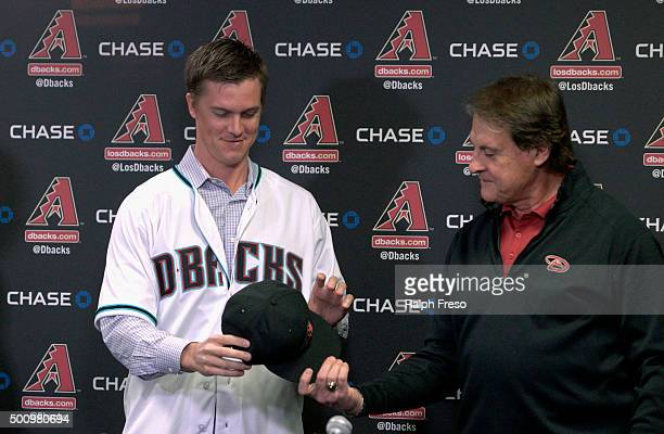 Chief Baseball Officer Tony La Russa of the Arizona Diamondbacks introduces pitcher Zack Greinke during a press conference at Chase Field on December...