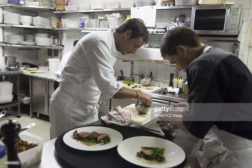 Chief Benoit Dargere former student of Alain Passard competing for the prize 'les étoiles de Mougin' in the kitchen of his restaurant 'Le Clos Saint-Basile' during the 7th International Food Festival in Mougins on october 15, 2012 in Mougins on the Cote d'Azur.