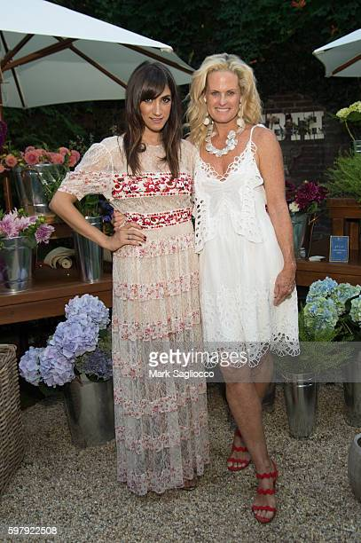 Chief Brand Officer Mandana Dayani and Ashley McDermott attend the Ashley And Jeff McDermott host an intimate Hamptons party for EBTH on August 28...