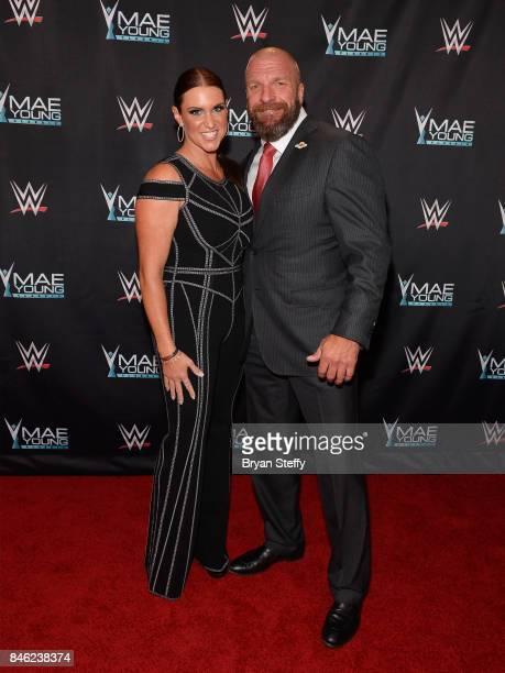 Chief Brand Officer Stephanie McMahon and WWE Executive Vice President of Talent Live Events and Creative Paul 'Triple H' Levesque appear on the red...