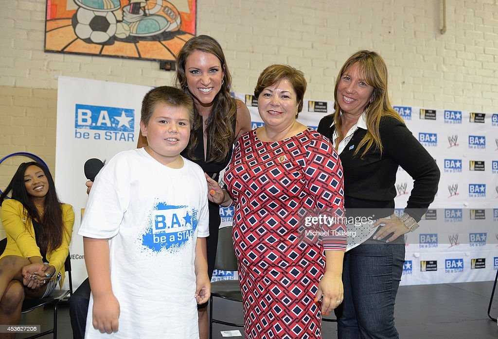 Chief Brand Officer <a gi-track='captionPersonalityLinkClicked' href=/galleries/search?phrase=Stephanie+McMahon&family=editorial&specificpeople=2647436 ng-click='$event.stopPropagation()'>Stephanie McMahon</a> (2nd from L), Congresswoman Linda Sanchez and Creative Coalition CEO <a gi-track='captionPersonalityLinkClicked' href=/galleries/search?phrase=Robin+Bronk&family=editorial&specificpeople=653341 ng-click='$event.stopPropagation()'>Robin Bronk</a> pose with a young guest at the 'Be A STAR' Anti-bullying Rally For 200 Students at Boys & Girls Club Of East Los Angeles on August 14, 2014 in Los Angeles, California.