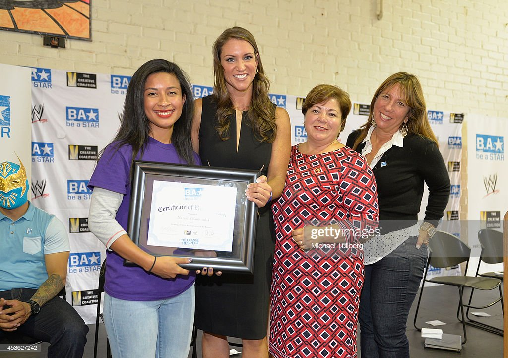 Chief Brand Officer <a gi-track='captionPersonalityLinkClicked' href=/galleries/search?phrase=Stephanie+McMahon&family=editorial&specificpeople=2647436 ng-click='$event.stopPropagation()'>Stephanie McMahon</a> (2nd from L), Congresswoman Linda Sanchez and Creative Coalition CEO <a gi-track='captionPersonalityLinkClicked' href=/galleries/search?phrase=Robin+Bronk&family=editorial&specificpeople=653341 ng-click='$event.stopPropagation()'>Robin Bronk</a> pose with an award recipient at the 'Be A STAR' Anti-bullying Rally For 200 Students at Boys & Girls Club Of East Los Angeles on August 14, 2014 in Los Angeles, California.