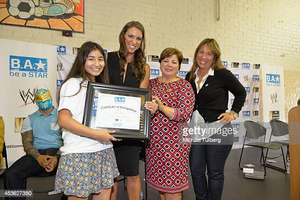 Chief Brand Officer Stephanie McMahon Congresswoman Linda Sanchez and Creative Coalition CEO Robin Bronk pose with an award recipient at the 'Be A...