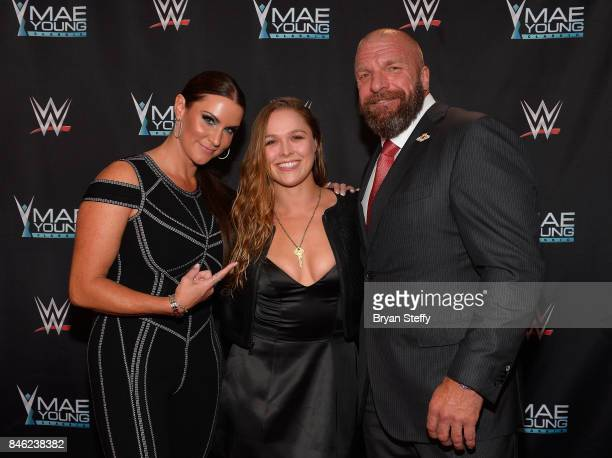 WWE Chief Brand Officer Stephanie McMahon MMA fighter Ronda Rousey and WWE Executive Vice President of Talent Live Events and Creative Paul 'Triple...