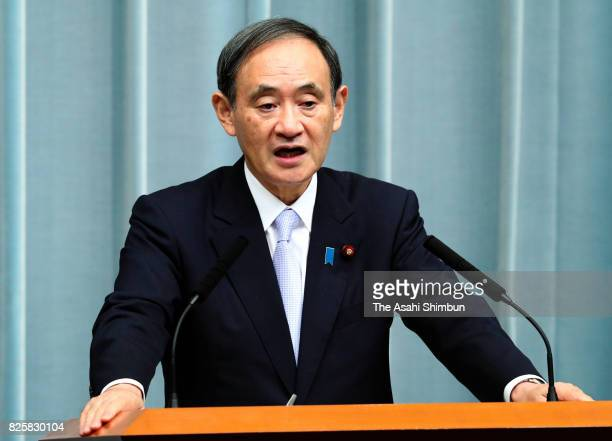 Chief Cabinet Secretary Yoshihide Suga announces the names of new cabinet members during a press conference at the prime minister's official...