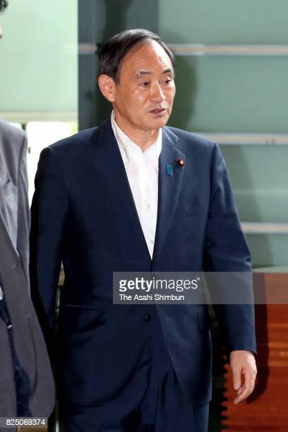 Chief Cabinet Secretary Yoshihide Suga enters the Prime Minister's official residence for attending the National Security Council on July 29 2017 in...
