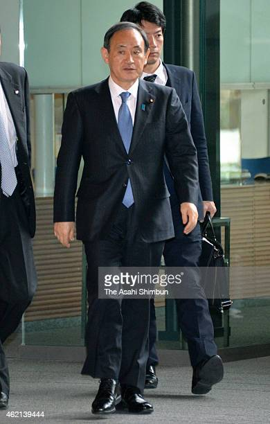 Chief Cabinet Secretary Yoshihide Suga is seen on arrival at Prime Minister Shinzo Abe's official residence on January 24 2015 in Tokyo Japan...