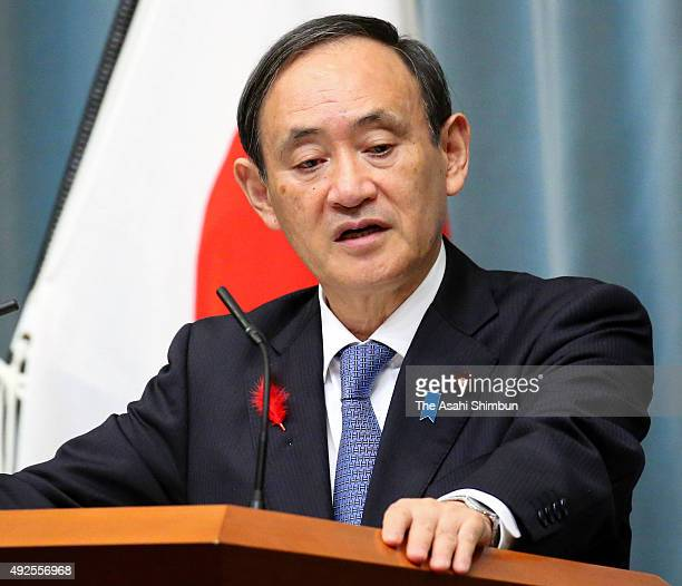 Chief Cabinet Secretary Yoshihide Suga speaks during a press conference after Okinawa Prefecture Governor Takeshi Onaga announces the rescinding of...