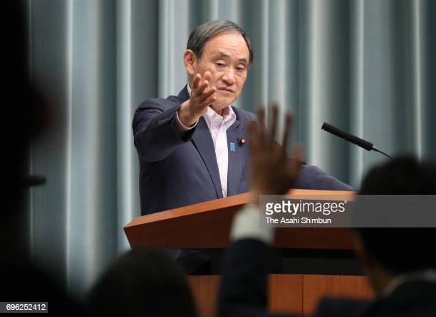 Chief Cabinet Secretary Yoshihide Suga speaks during a press conference at Prime Minister Shinzo Abe's official residence on June 15 2017 in Tokyo...