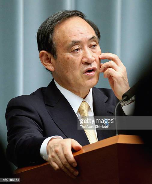 Chief Cabinet Secretary Yoshihide Suga speaks during a regular press conference at Prime Minister Shinzo Abe's official residence on December 9 2014...