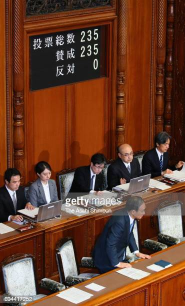 Chief Cabinet Secretary Yoshihide Suga stands as the Upper House passes specialcase legislation to allow Emperor Akihito to abdicate in a plenary...