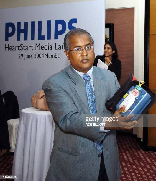 Chief Cardiologist and Director of Cardiac Cath Lab Holy Family Hospital Bandra Dr Brian Pinto holds HeartStart a new device that can help people who...