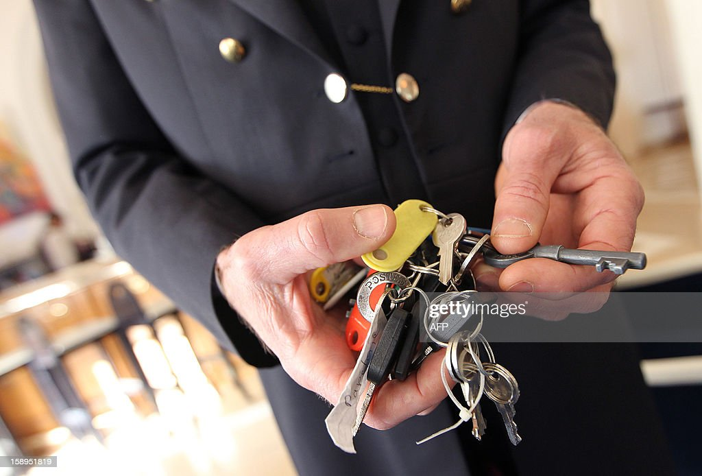 A chief concierge of a luxury hotel handles his keychain on January 4, 2013 in Cannes, southeastern France.